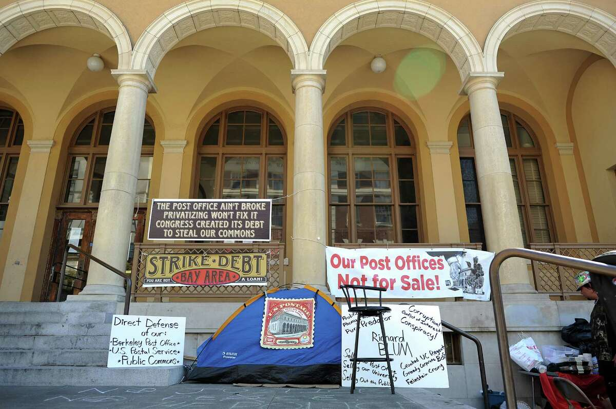 A group of activists camped out on the steps of the main Berkeley post office in August 2013 to draw attention to the issue of the historic building's possible sale.