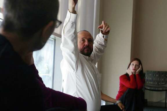 Alejandro Chaoul, center, leads classes in Tibetan meditation and yoga at The University of Texas M.D. Anderson Cancer Center in the Medical Center.