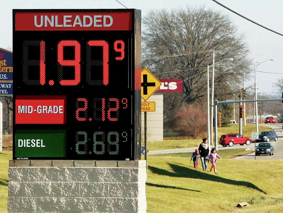Unleaded gasoline is advertised below $2 per gallon on Monday at a convenience store in Alton, Ill. AAA estimated in its year-end report Wednesday that the precipitous drop in oil prices saved U.S. consumers $14 billion in 2014. Photo: John Badman, MBR / The Telegraph