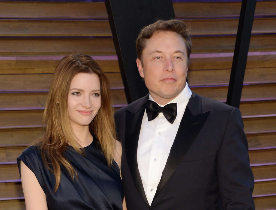 FILE - In this March 2, 2014 file photo, Talulah Riley, left, and Elon Musk attend the 2014 Vanity Fair Oscar Party, in West Hollywood, Calif. Musk and his wife are divorcing for a second time. The entrepreneur and his wife, Riley, issued a joint statement Wednesday, Dec. 31, 2014, announcing they are splitting amicably after they remarried in July 2013 following their previous breakup. (Photo by Evan Agostini/Invision/AP, File) Photo: Evan Agostini, INVL / Invision