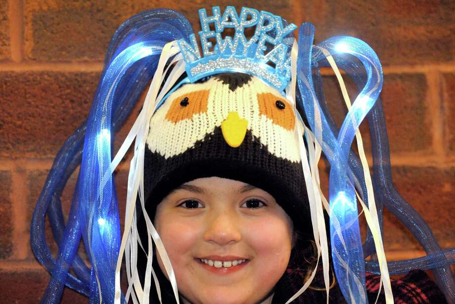 Eight-year-old Nicole Caputo of Guilderland wears a light up Happy New Year tiara during the Saratoga First Night celebration on Wednesday Dec. 31, 2014 in Saratoga Springs, N.Y. (Michael P. Farrell/Times Union) Photo: Michael P. Farrell / 00030022A