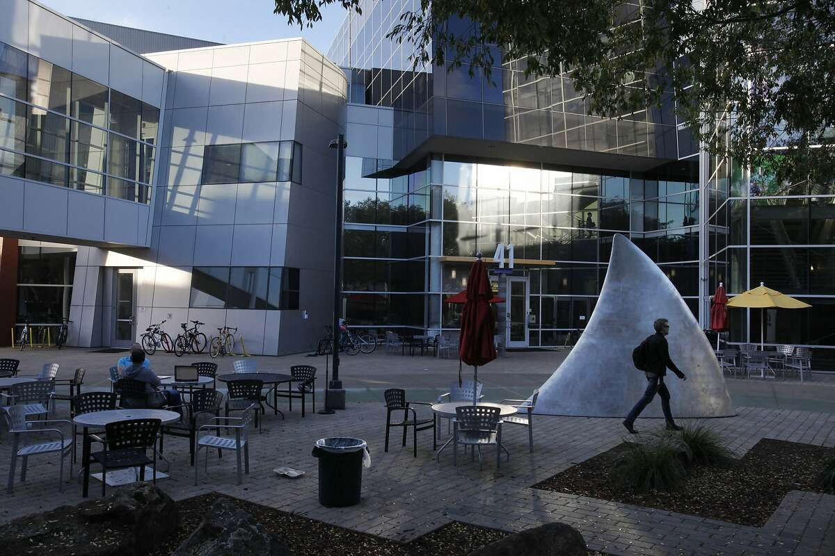 A man walks past a shark fin that was once taken to Burning Man on Google's Mountain View headquarters Dec. 4, 2014 in Mountain View, Calif.