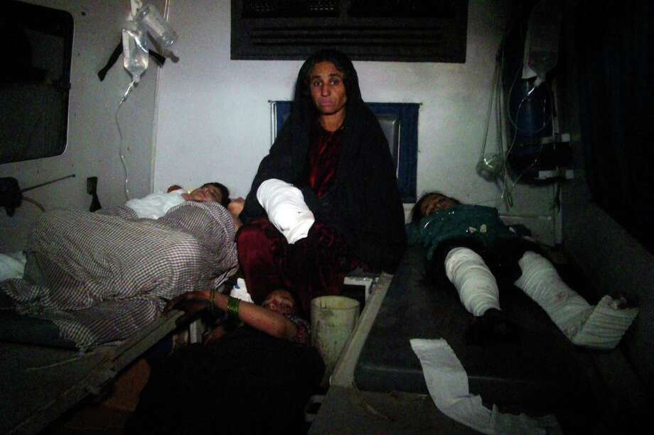 Afghan injured children are treated at hospital in Helmand province, south of Kabul, Afghanistan, Wednesday, Dec. 31, 2014. A rocket fired amid fighting between Taliban insurgents and Afghan soldiers killed at least 26 people at a nearby wedding party Thursday night, authorities said, a grim end to a year that saw the end of the 13-year U.S.-led combat mission there. (AP Photo/Abdul Khaliq) Photo: Abdul Khaliq, STR / AP