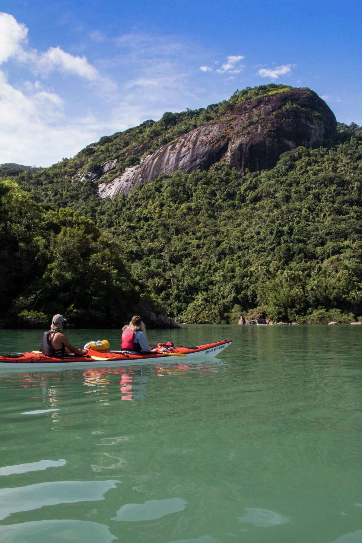Kayakers get a close-up view of the turquoise waters and emerald foliage of Brazil's Costa Verde.