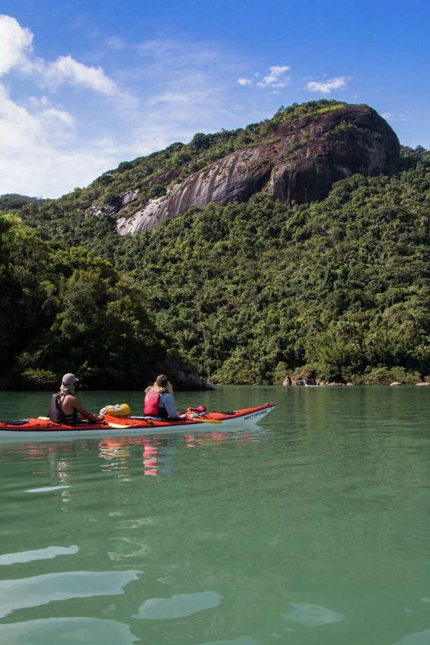 Kayakers get a close-up view of the turquoise waters and emerald foliage of Brazil's Costa Verde. Photo: Tofino Expeditions / ONLINE_YES