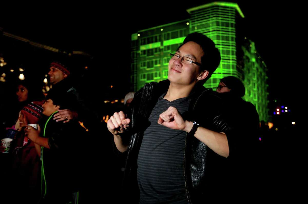 Alex Vuong, 17, dances at the Sugar Land Town Square New Year's Eve Celebration at the Sugar Land Town Square.