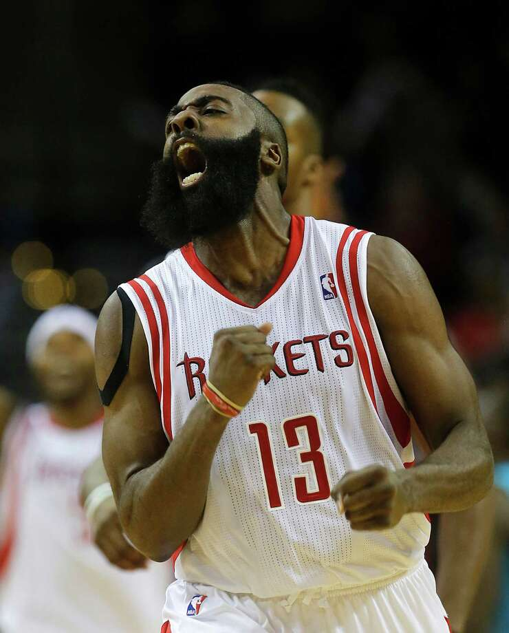 Rockets guard James Harden celebrates his third 3-point basket in a row in the fourth quarter. He was 8-for-11 from long distance in the game. Photo: Johnny Hanson, Staff / © 2014  Houston Chronicle