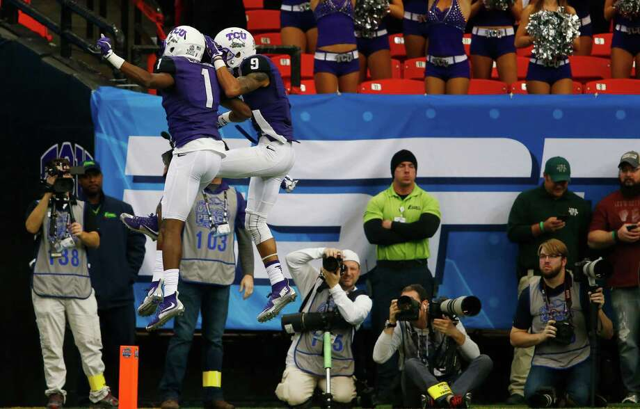 TCU's Josh Doctson (9) takes his second-quarter celebration with fellow wide receiver Emanuel Porter into rarefied air after Doctson made the first of his two touchdown catches in the Horned Frogs' win Wednesday. Photo: John Bazemore, STF / AP