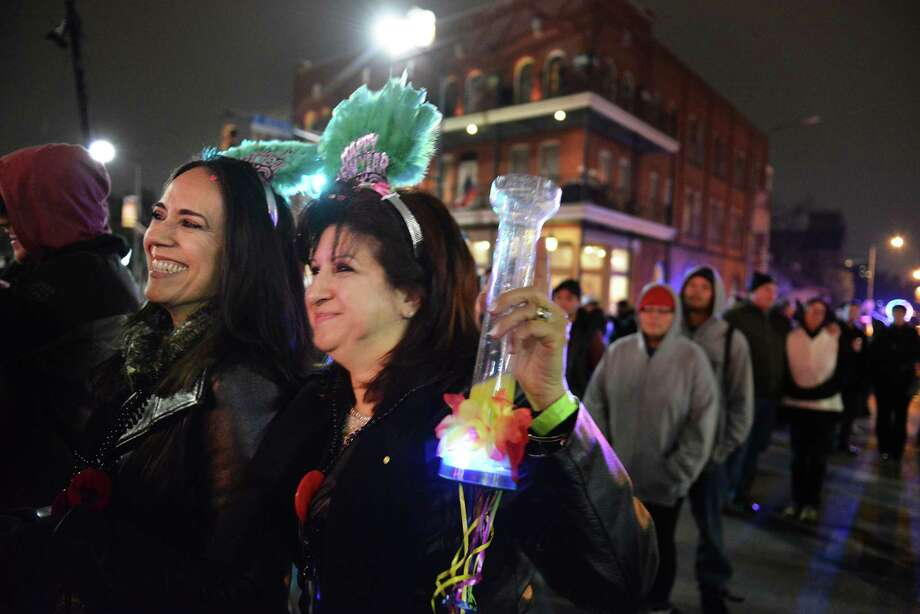 Diana Sandoval, left, and Minerva Ortiz dance to the music during New Years Eve celebrations in Hemisphere Park in San Antonio, Texas on Wednesday, December 31, 2014. Photo: Matthew Busch, For The San Antonio Express-News / © Matthew Busch