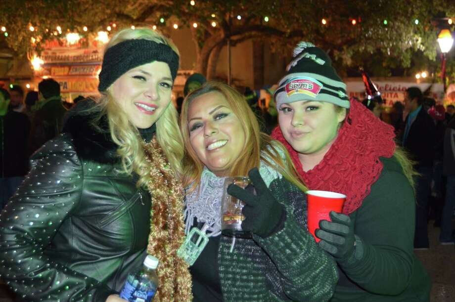 Bundled-up revelers rang in 2015 at Celebrate San Antonio near HemisFair Park on Wednesday, Dec. 31, 2014, in what was a chilly party downtown. Click through for a look at the snow and ice storm that hit much of the state for New Year 2015. Photo: Merrisa Brown/mySA.com