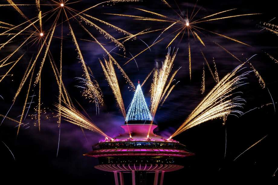 "Colorful bursts of fireworks explode along the 605-foot height of the Space Needle during the ""T-Mobile New YearÕs Eve at the Needle"" event Thursday, Jan. 1, 2015, in Seattle, Washington. The show lasted eight minutes in total and was set to a musical score. Photo: JORDAN STEAD, SEATTLEPI.COM / SEATTLEPI.COM"