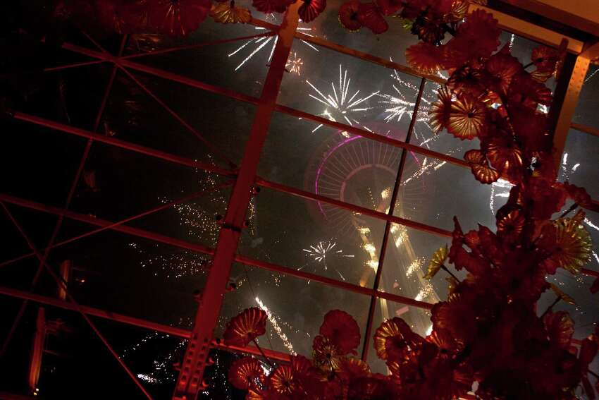 A view of the 2015 New Years Eve fireworks show from inside Chihuly Garden and Glass.