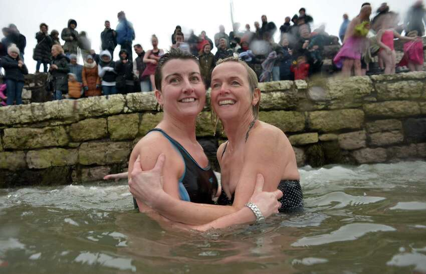 These swimmers in Carnlough, Northen Ireland, are smiling. Frozen smiles, we think.