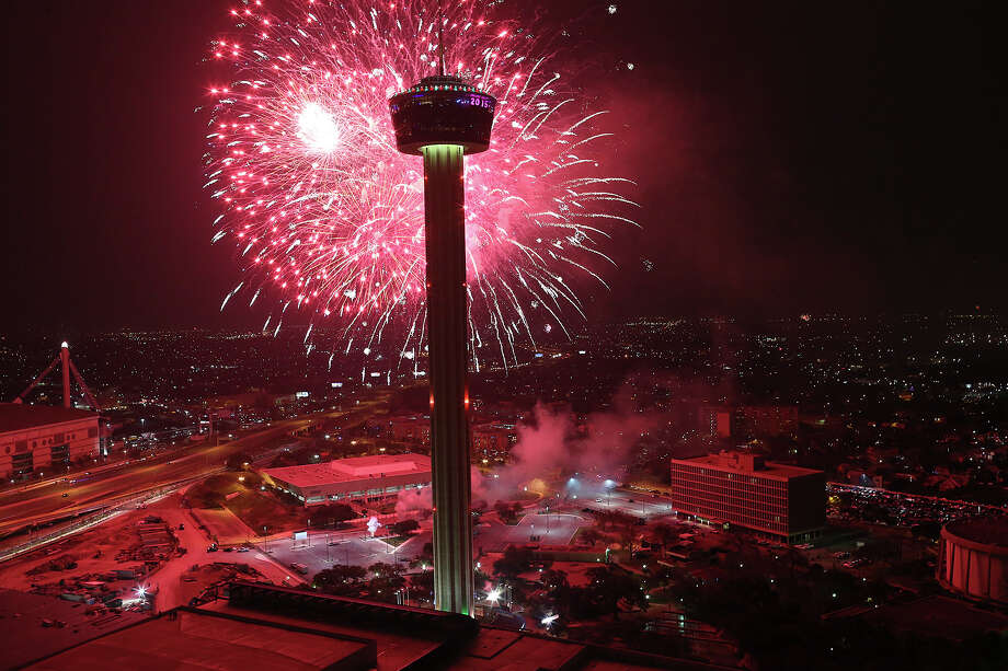 Fireworks explode over Hemisfair Park and the Tower of the Americas in this view from the Alteza Residences at the start of Celebrate San Antonio fireworks display, Thursday, Jan. 1, 2015. A crowd of 70,000 was expected to attend the event that is considered the largest free New Year's celebration in Texas. Photo: JERRY LARA, By Jerry Lara,  San Antonio Express_News / © 2014 San Antonio Express-News