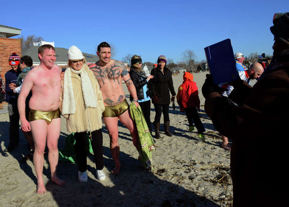 """The 11th Annual """"Save the Children"""" Mossman Polar Plunge at Compo Beach in Westport, Conn. on Thursday Jan. 1, 2015. Photo: Christian Abraham / Connecticut Post"""