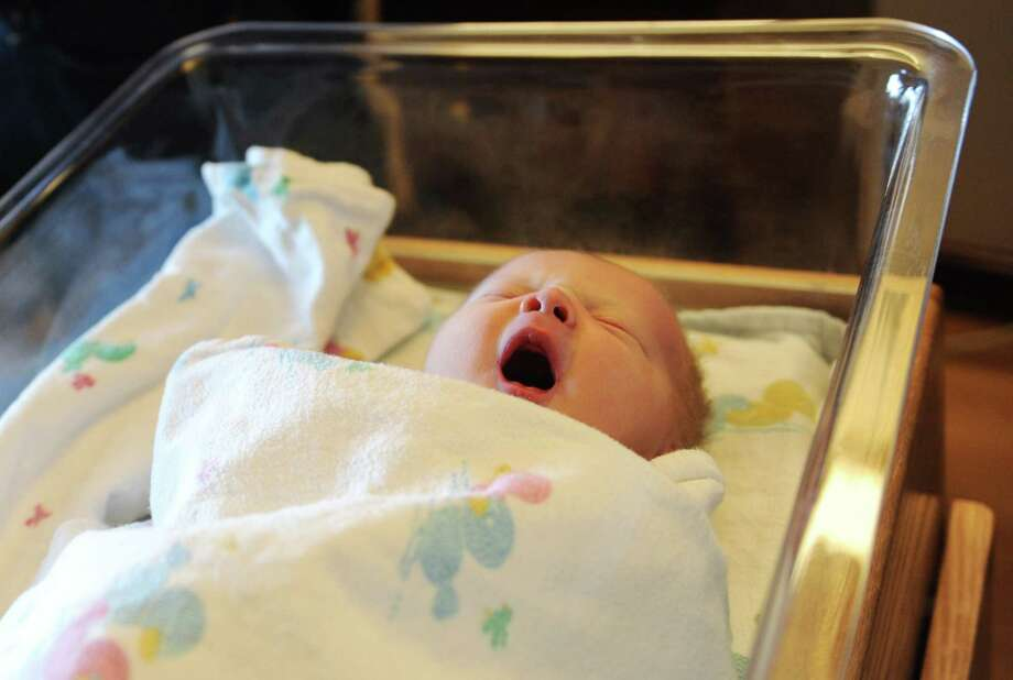 Newborn baby Chase Henry Davis, son of parents Henry and Allison Davis, of Eastchester, N.Y., yawns while taking a nap at Greenwich Hospital in Greenwich, Conn. Thursday, Jan. 1, 2015.  Chase was the first baby of the 2015 year born in Greenwich, arriving at 2:15 a.m. and weighing in at 7 pounds, 13 ounces and 21 inches long.  The baby was delivered by Dr. Vanessa Grano and is Henry and Allison's first child. Photo: Tyler Sizemore / Greenwich Time