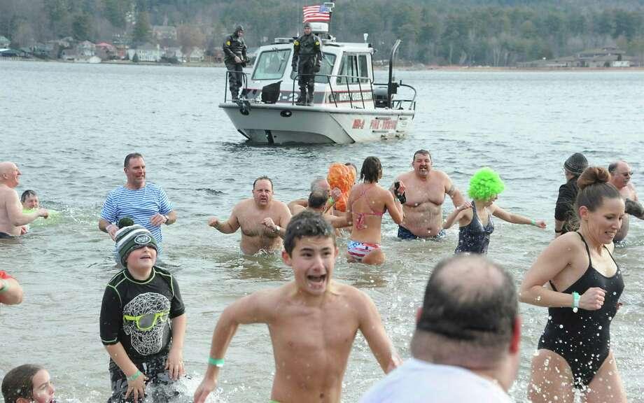 Participants partake in the Annual Lake George Polar Plunge at Shepard Park Beach on Thursday, Jan. 1, 2015 in Lake George, N.Y.  (Lori Van Buren / Times Union) Photo: Lori Van Buren / 00030018A