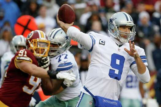 Dallas Cowboys quarterback Tony Romo passes during the second half against the Washington Redskins in Landover, Md., on Dec. 28, 2014. Photo: Alex Brandon /Associated Press / AP