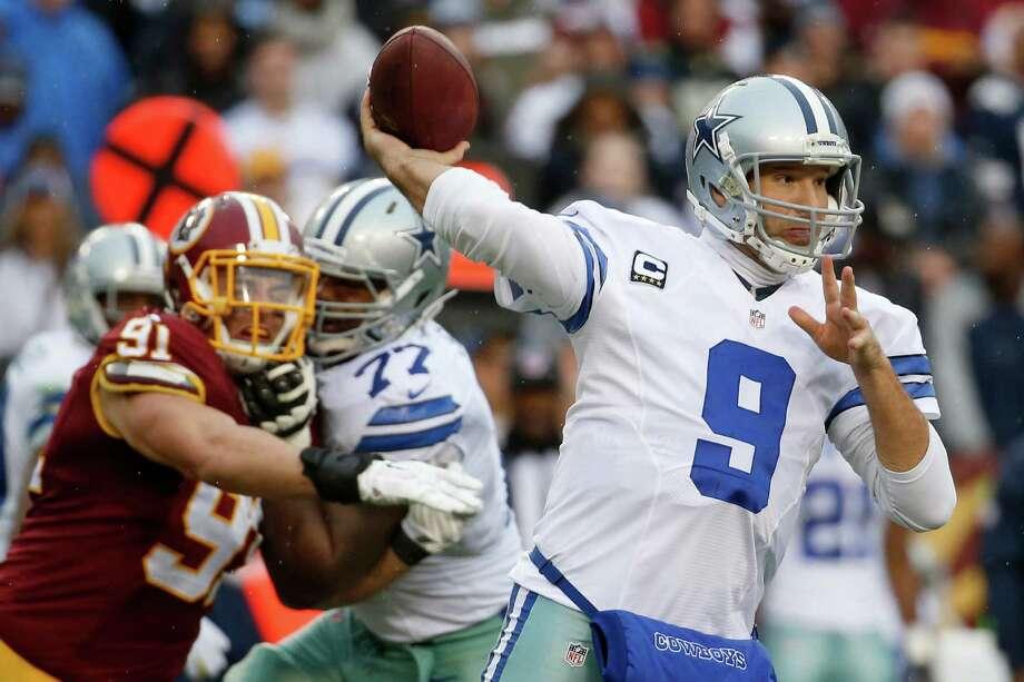Dallas Cowboys quarterback Tony Romo passes during the second half against the Washington Redskins in Landover, Md., on Dec. 28, 2014. Photo: Alex Brandon /Associated Press / AP