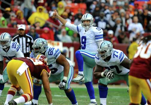 Tony Romo instructs his team at the line of scrimmage prior to a snap against the Redskins. The Cowboys defeated Washington 44-17. Photo: Richard Lipski /Associated Press / FR170623 AP