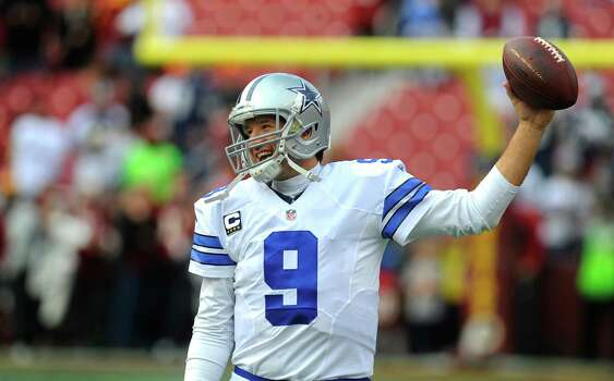 Tony Romo twirls the football on his hand during pregame warm-ups at Washington. Photo: Richard Lipski /Associated Press / FR170623 AP