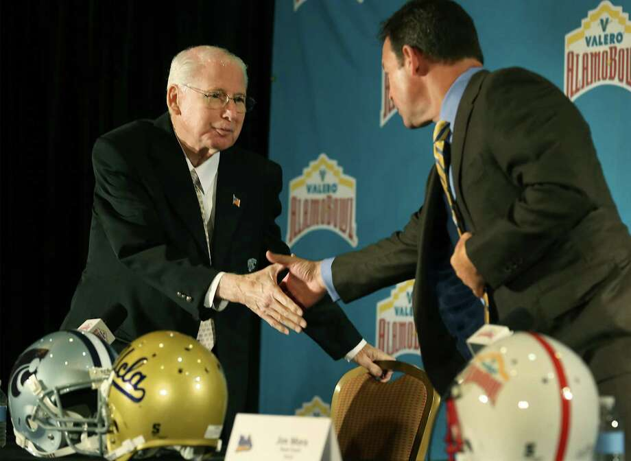 UCLA coach Jim Mora (right) and Kansas State coach Bill Synder shake hands before a press conference for the Alamo Bowl. Photo: Bob Owen /San Antonio Express-News / © 2014 San Antonio Express-News