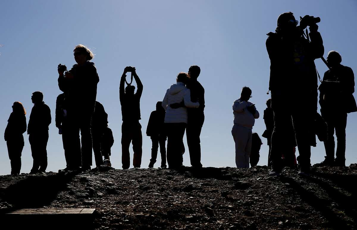 In this file photo, tourists crowd the top of Twin Peaks in San Francisco, Calif.