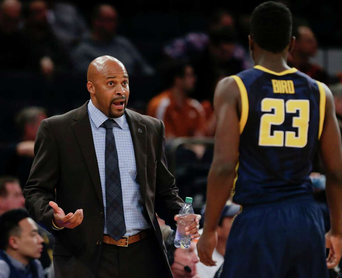Cuonzo Martin, talking to Jabari Bird at Madison Square Garden, tries to help players keep the moment in perspective.