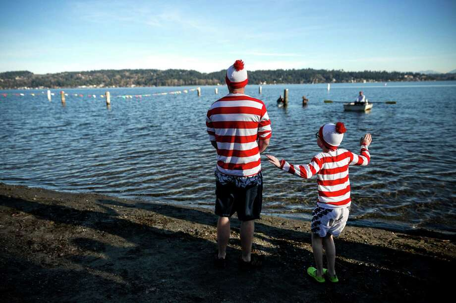 "Participants dressed as ""Waldo"" take in their impending challenge before running into the frigid waters of Pontiac Bay for the 13th Annual Polar Bear Plunge Thursday, Jan. 1, 2015, at Matthews Beach Park in Seattle. About 300 people participated in the first Polar Bear Plunge in 2003; since then, attendance has skyrocketed. Photo: JORDAN STEAD, SEATTLEPI.COM / SEATTLEPI.COM"