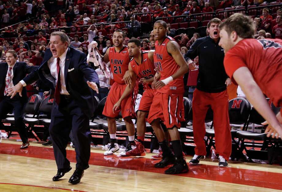 Incarnate Word men's coach Ken Burmeister and players on the bench celebrate after Kyle Hittle (right) hit the go-ahead basket for a 74-73 win over Nebraska in Lincoln on Dec. 10, 2014. Photo: Nati Harnik /Associated Press / AP