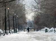 A man walks through Washington Park on a cold day Thursday, Feb. 27, 2014 in Albany, N.Y.  (Lori Van Buren / Times Union)