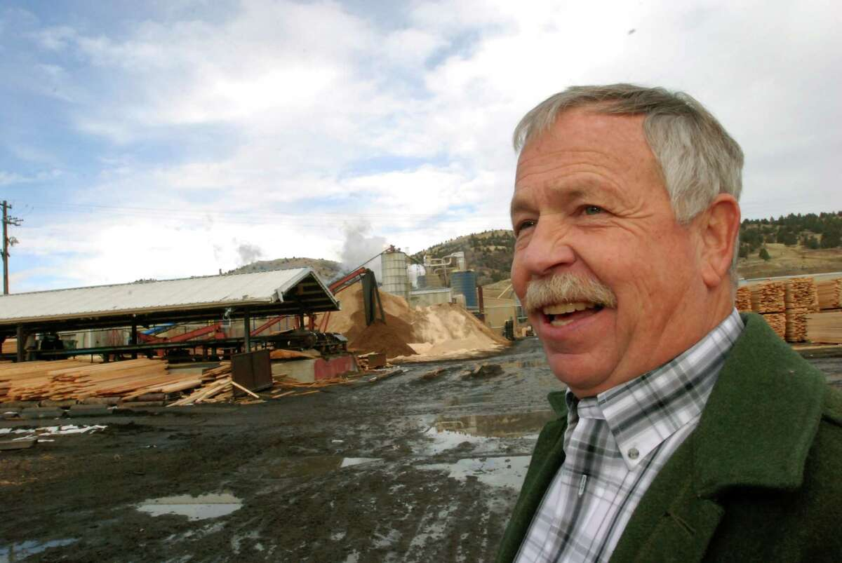 In this Nov. 20, 2014 photos Malheur Lumber Co. President Art Andrews smiles at the mill in John Day, Ore. The mill was able to stay open after environmentalists and timber interests came together to compromise on logging projects on the Malheur National Forest. The U.S. Forest Service hopes the trust and cooperation exhibited on the Blue Mountains Forest Partners collaborative will spread to other national forests where lawsuits have locked up timber production. (AP Photo/Jeff Barnard)