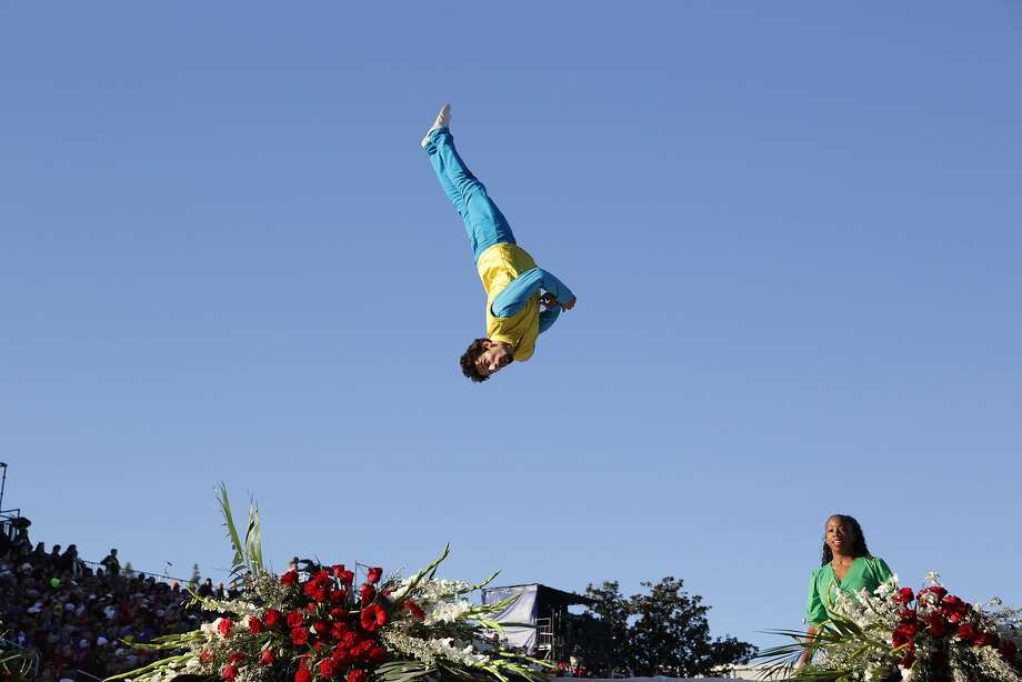 An acrobat in the Opening Show presented by Honda in the 126th Rose Parade in Pasadena, Calif., on Thursday, Jan. 1, 2015. (Marcus Yam/Los Angeles Times/TNS) Photo: Marcus Yam, McClatchy-Tribune News Service