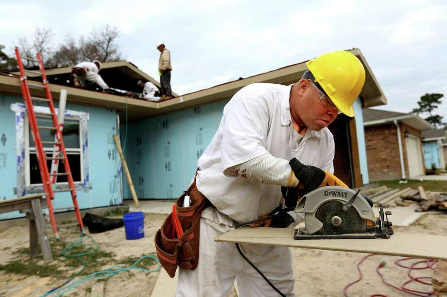Keenan Jackson, an inmate at the Carol Vance Unit, is learning job skills as part of the Prison Fellowship program, building a home for the Habitat for Humanity in Harrel Park community. Photo: Gary Coronado, Staff / © 2014 Houston Chronicle