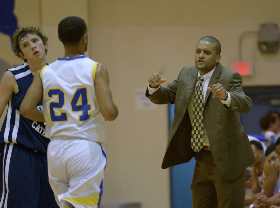 Clemens coach Clifton Ellis talks to Sam Kearns as he comes off the floor during a nondistrict game against Central Catholic on Nov. 29, 2014. Photo: Billy Calzada /San Antonio Express-News / Billy Calzada