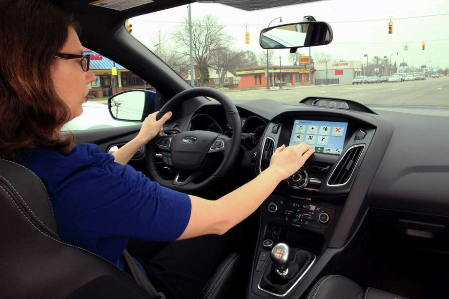 A driver uses Ford's Sync 3 in-dashboard system, which features simpler controls and a smartphone-like touch screen. Photo: FORD MOTOR CO., HO / FORD MOTOR CO.