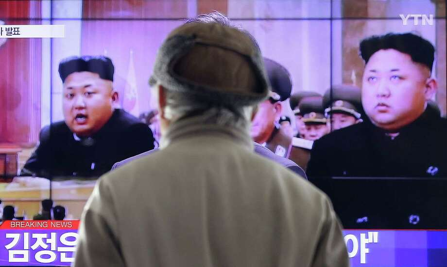 A man watches a TV news program showing North Korean leader Kim Jong-Un, at the Seoul Railway Station in Seoul, South Korea, Thursday, Jan. 1, 2015. Kim, in a nationally televised New Year's Day speech, says he is open to a summit with his South Korean counterpart. (AP Photo/Ahn Young-joon) Photo: Ahn Young-joon, STF / AP