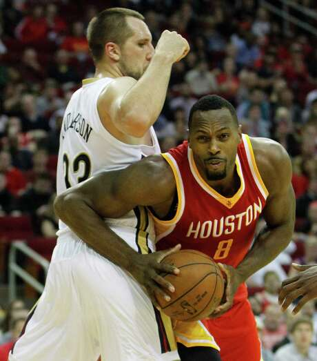 Joey Dorsey, right, works under the basket against New Orleans forward Ryan Anderson in a game last month. Dorsey has worked his way into the lineup more of late and is being counted on to spell Dwight Howard at center. Photo: Karen Warren, Staff / © 2014 Houston Chronicle