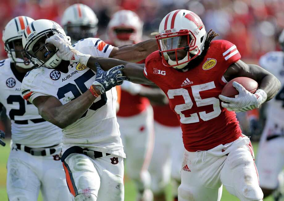 Wisconsin running back Melvin Gordon (25) stiff-armed his way to an Outback Bowl-record 251 yards rushing and three scores in Wisconsin's win. Photo: Chris O'Meara, STF / AP