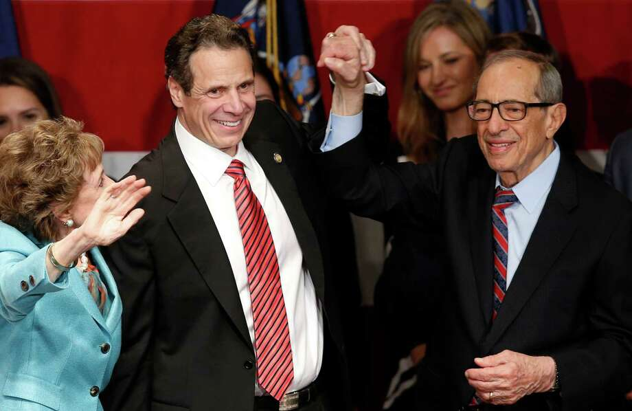 In November, New York Gov. Andrew Cuomo, second from left, celebrates with his father, former New York Gov. Mario Cuomo, and his mother, Matilda, left. On Thursday, the day Andrew was inaugurated to his second term, Mario died. Photo: Kathy Willens, STF / AP