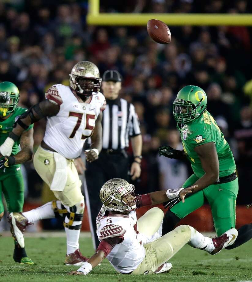 PASADENA, CA - JANUARY 01:  Quarterback Jameis Winston #5 of the Florida State Seminoles fumbles the ball in the third quarter of the College Football Playoff Semifinal at the Rose Bowl Game presented by Northwestern Mutual at the Rose Bowl on January 1, 2015 in Pasadena, California. Linebacker Tony Washington #91 of the Oregon Ducks recovered the ball for a 58-yard touchdown.  (Photo by Ezra Shaw/Getty Images) Photo: Getty Images
