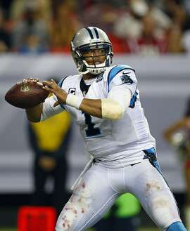 Carolina Panthers quarterback Cam Newton (1) throws the ball against the Atlanta Falcons during an NFL football game on Sunday, Dec. 28, 2014 in Atlanta. The Panthers won the game 34-3. (Jeff Haynes/AP Images for Panini)