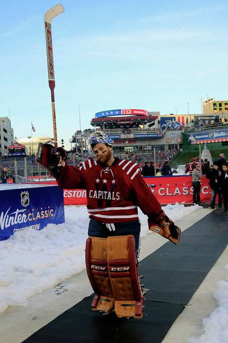 Washington's Braden Holtby salutes the fans after the Capitals' win Thursday in the NHL Winter Classic. Photo: Rob Carr, Staff / 2015 Getty Images