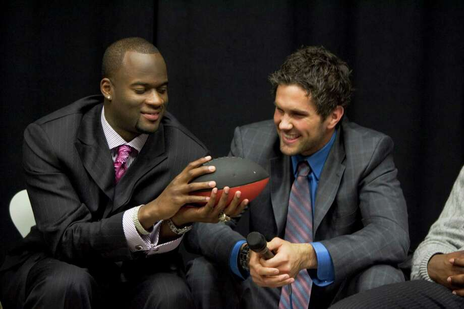 Former Texas quarterback Vince Young, left, and former USC quarterback Matt Leinart were among the top six prospective draft picks in New York in 2006 - months after they dueled in what many consider college football's greatest game. Photo: BRETT COOMER, STAFF / Houston Chronicle