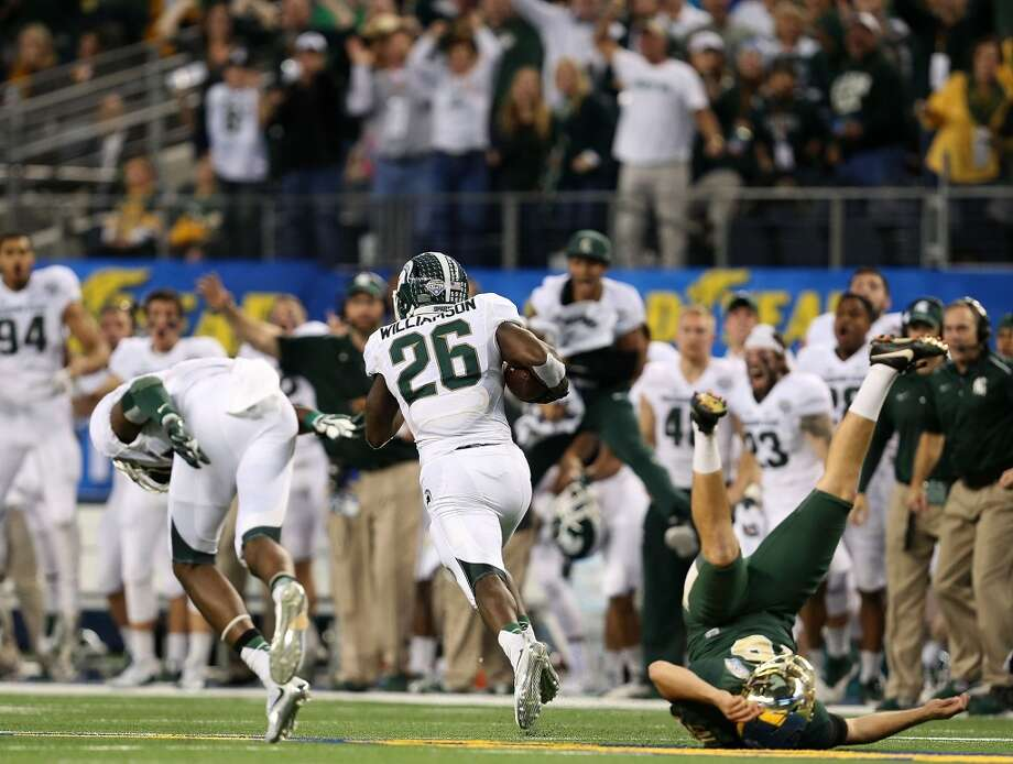 ARLINGTON, TX - JANUARY 01:  Chris Callahan #40 of the Baylor Bears is blocked by Tony Lippett #14 of the Michigan State Spartans as RJ Williamson #26 of the Michigan State Spartans returns a blocked field goal during the second half of the Goodyear Cotton Bowl Classic at AT&T Stadium on January 1, 2015 in Arlington, Texas.  (Photo by Sarah Glenn/Getty Images) Photo: Getty Images