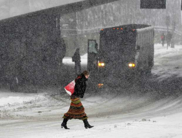 Marianne Stewart of Albany crosses Madison Ave. during snowstorm  Thursday, Jan. 2, 2014, in Albany, N.Y.  (John Carl D'Annibale / Times Union) Photo: John Carl D'Annibale / 00025207A