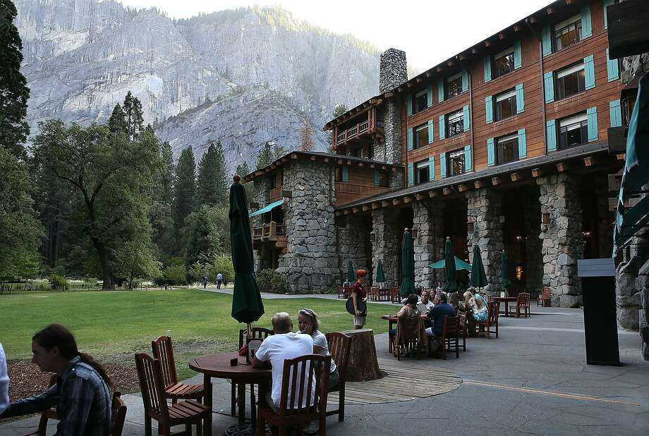YPark visitors sit outside of the Ahwahnee Hotel on August 28, 2013 in Yosemite National Park, California.  Photo: Justin Sullivan, Getty Images