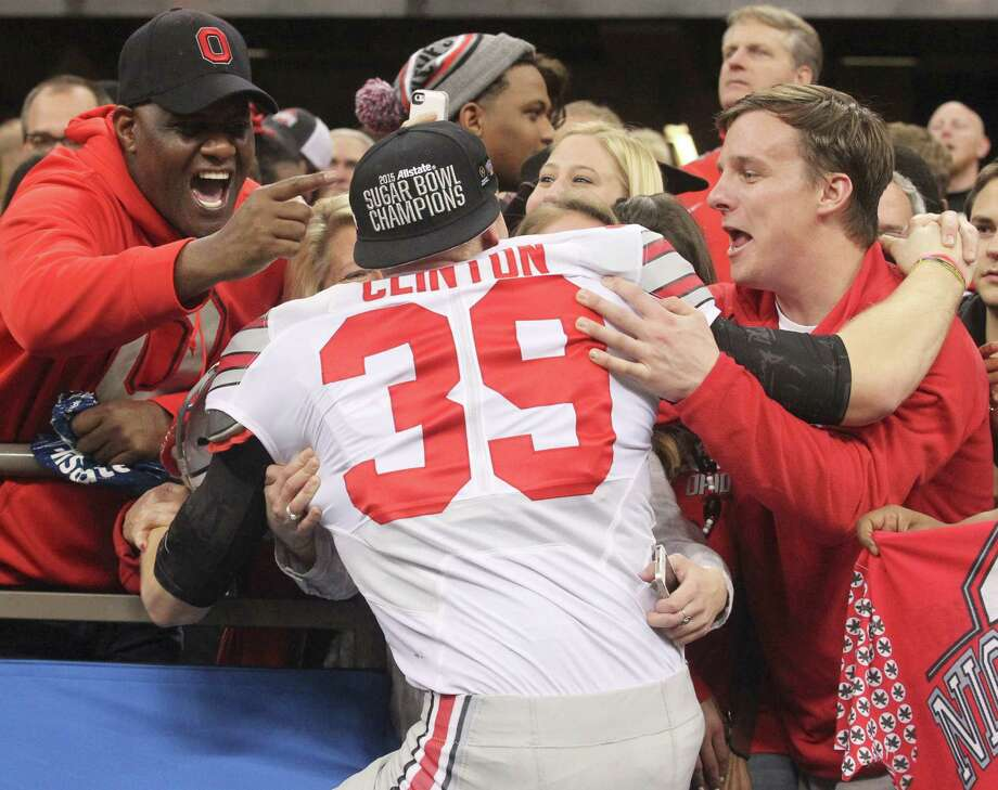 Ohio State's Kyle Clinton gets some love from the stands after the Buckeyes 42-35 win over Alabama in the Sugar Bowl on Thursday, Jan. 1, 2015, at  the Mercedes-Benz Superdome in New Orleans. (Phil Masturzo/Akron Beacon Journal/TNS) Photo: Phil Masturzo, McClatchy-Tribune News Service / Akron Beacon Journal