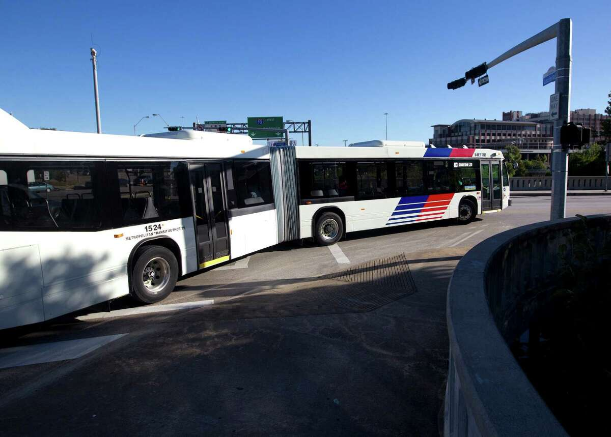 An articulated METRO bus turns onto Franklin Street from Louisiana Street on Oct. 7, 2013.