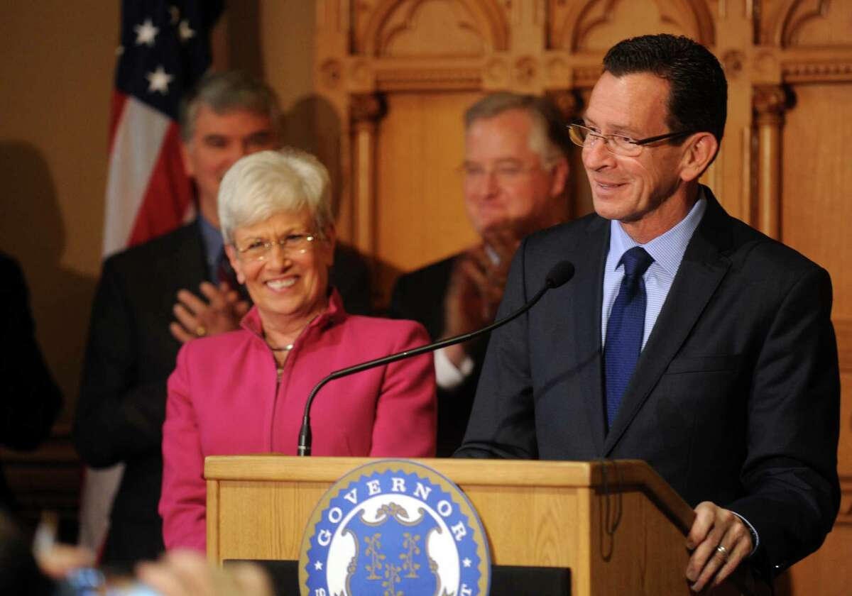 Gov. Dannel P. Malloy, with Lt. Gov. Nancy Wyman, answers questions about last night's election and plans for the next four years Wednesday, Nov. 5, 2014, during a news conference at the State Capitol in Hartford, Conn.